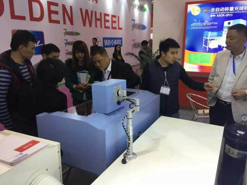 XIDO machine show in DONGGUAN exhibition,clients are very interest in down filling machine scr-2p-8g